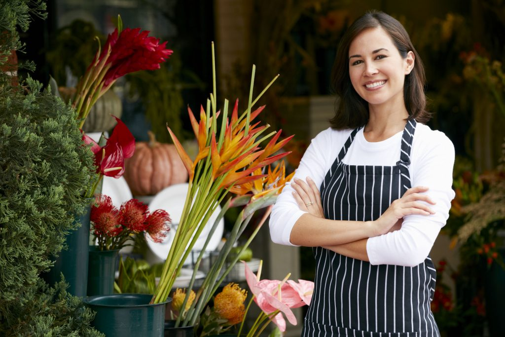 42256863 - portrait of female florist outside shop